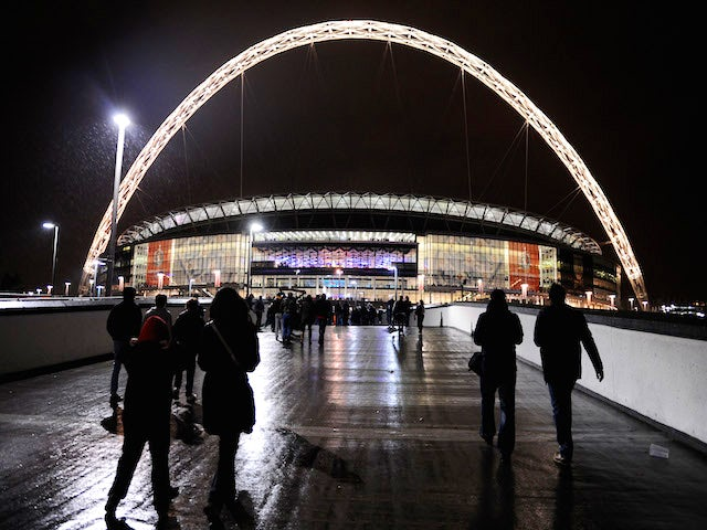 Fans walk to the stadium prior to the FIFA 2014 World Cup Qualifying Group H match between England and Montenegro at Wembley Stadium on October 11, 2013