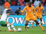 Ivory Coast midfielder Yaya Toure battles for possession with Cristiano Ronaldo on June 15, 2010.