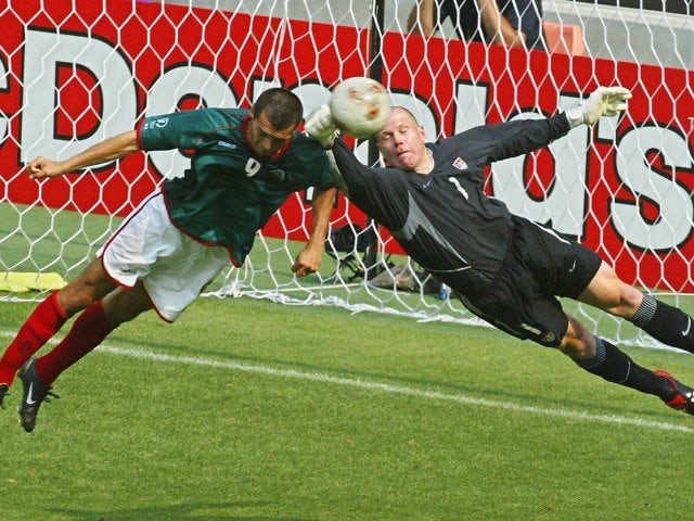 USA goalkeeper Brad Friedel punches the ball clear during a match against Mexico on June 17, 2002.