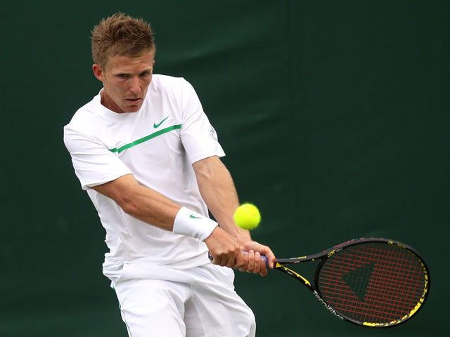 Daniel Cox of Great Britain returns a shot during his first round match against Sergiy Stakhovsky of Ukraine on Day Two of the Wimbledon Lawn Tennis Championships at the All England Lawn Tennis and Croquet Club on June 21, 2011