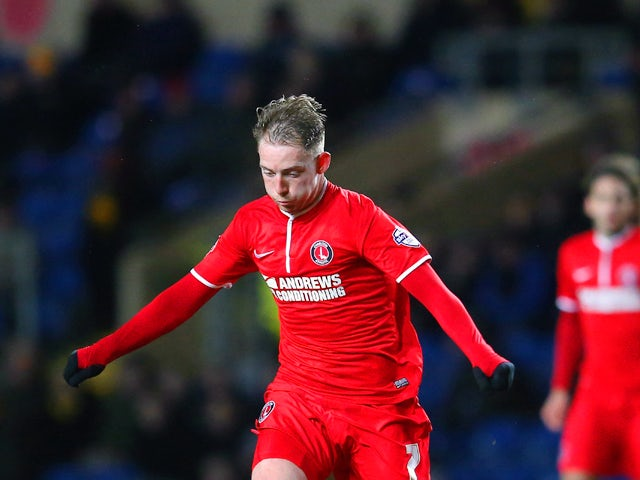 Danny Green of Charlton is closed down by Tom Newey of Oxford United during the FA Cup Third Round Replay match between Oxford United and Charlton Athletic at Kassam Stadium on January 21, 2014