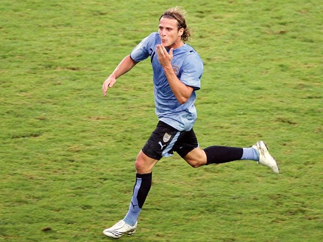 Former Manchester United striker Diego Forlan celebrates scoring Uruguay on July 07, 2007.