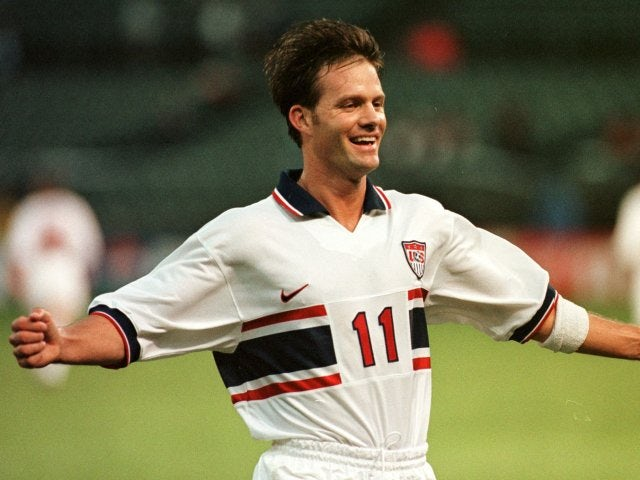 Centre-forward Eric Wynalda celebrates scoring for the USA on February 01, 1998.