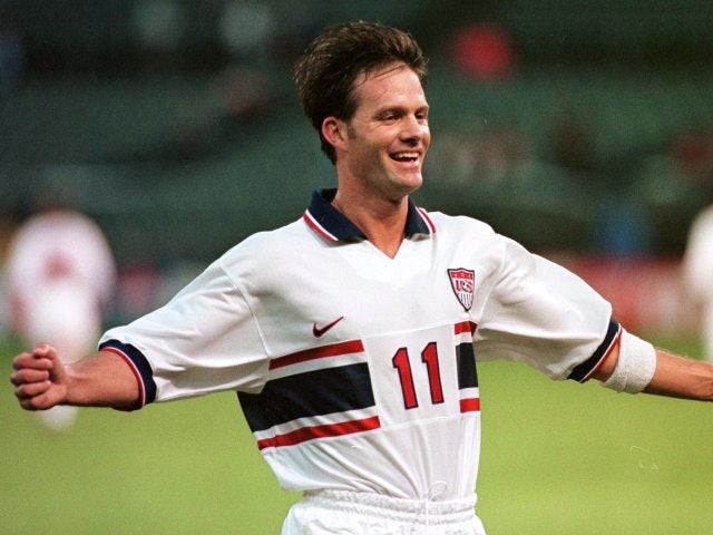 Centre-forward Eric Wynalda celebrates scoring for the USA on February 01, 1998.