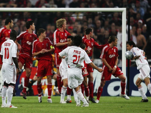 Filippo Inzaghi (R #9) of Milan deflects the ball into the net to score the opening goal during the UEFA Champions League Final match on May 23, 2007