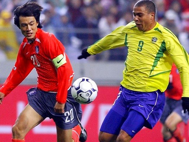 South Korea defender Hong Myung-bo battles for possession with Brazilian international Ronaldo on November 20, 2002.