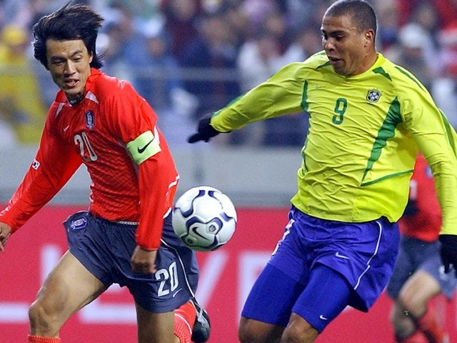 South Korea defender Hong Myung-bo battles for possession with Brazilian international Ronaldo on November 20, 2002.