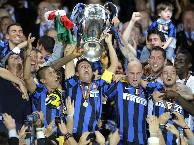 Inter Milan's players celebrate with the trophy after winning the UEFA Champions League final football match Inter Milan against Bayern Munich at the Santiago Bernabeu stadium in Madrid on May 22, 2010