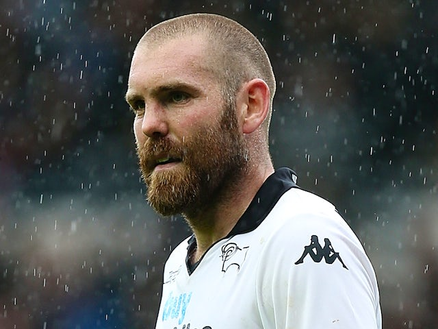 Jake Buxton of Derby County in action during the Sky Bet Championship Semi Final Second Leg between Derby County and Brighton & Hove Albion at iPro Stadium on May 11, 2014