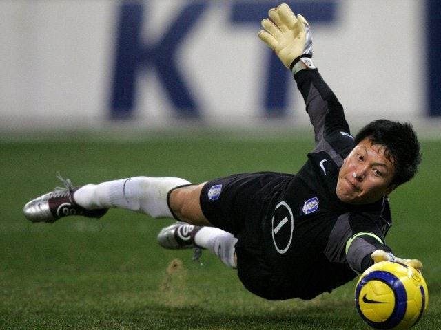 South Korea goalkeeper Lee Woon-jae makes a save on December 19, 2004.