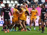 Guy Thompason of Wasps celebrates with team mates after scoring the teams second try during the European Rugby Champions Cup Play-off match between Stade Francais Paris and London Wasps at Stade Jean-Bouin on May 24, 2014