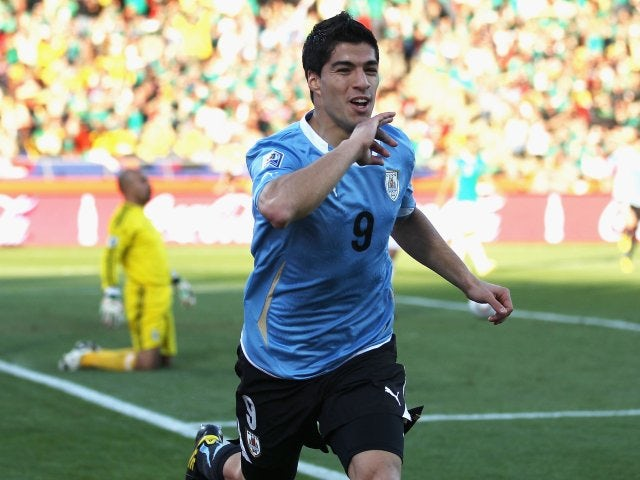 Liverpool striker Luis Suarez celebrates scoring for Uruguay at the World Cup against Mexico on June 22, 2010.