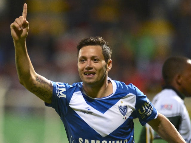 Argentina's Velez Sarfiield's player Mauro Zárate celebrates after scoring against Colombia's La Equidad during their Copa Sudamericana 2013 match on September 17, 2013