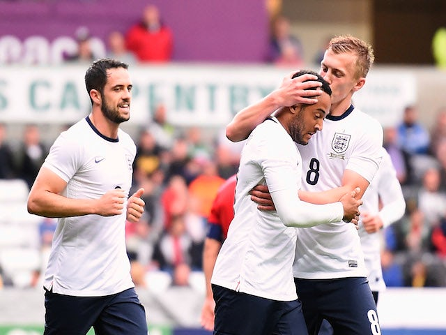 Nathan Redmond of England is congratulated on scoring the first goal during the 2015 UEFA European U21 Championships Qualifier against Wales on May 19, 2014