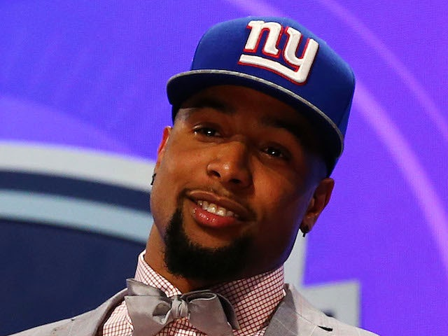 Odell Beckham Jr of the LSU Tigers poses with a jersey after he was picked #12 overall by the New York Giants during the first round of the 2014 NFL Draft  on May 8, 2014