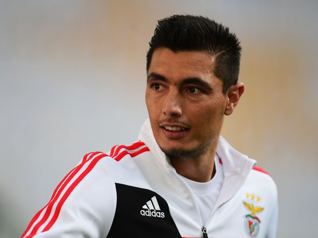 Oscar Cardozo of Benfica looks on during an SL Benfica training session ahead of the UEFA Europa League Final against Sevilla FC at Juventus Arena on May 13, 2014