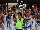 Iker Casillas of Real Madrid lifts the Champions League trophy during the UEFA Champions League Final between Real Madrid and Atletico de Madrid at Estadio da Luz on May 24, 2014