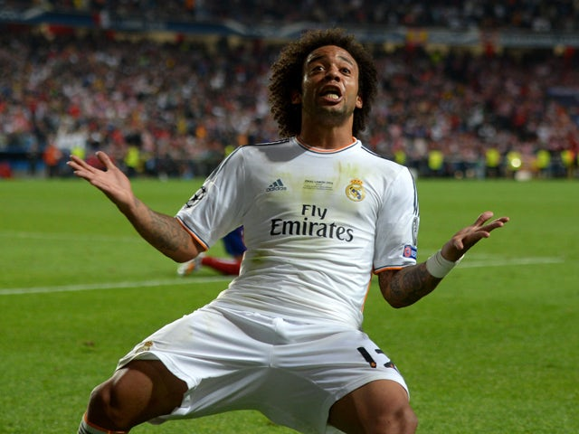 Marcelo of Real Madrid reacts after Gareth Bale of Real Madrid scored their second goal during the UEFA Champions League Final between Real Madrid and Atletico de Madrid at Estadio da Luz on May 24, 2014
