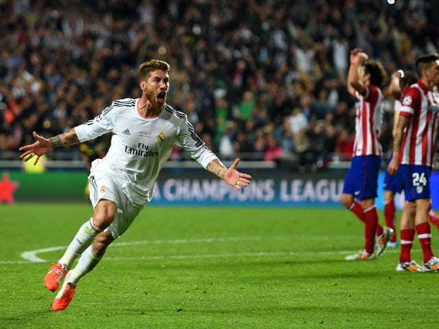 Sergio Ramos of Real Madrid celebrates scoring their first goal in stoppage time during the UEFA Champions League Final between Real Madrid and Atletico de Madrid at Estadio da Luz on May 24, 2014