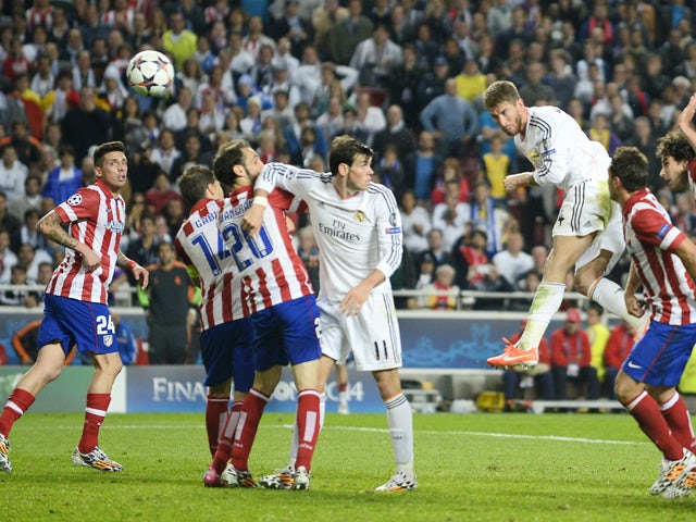 Real Madrid's defender Sergio Ramos scores during the UEFA Champions League Final Real Madrid vs Atletico de Madrid at Luz stadium in Lisbon, on May 24, 2014