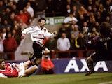 Manchester United's Ryan Giggs lashes a shot past Arsenal goalkeeper David Seaman on April 14, 1999.