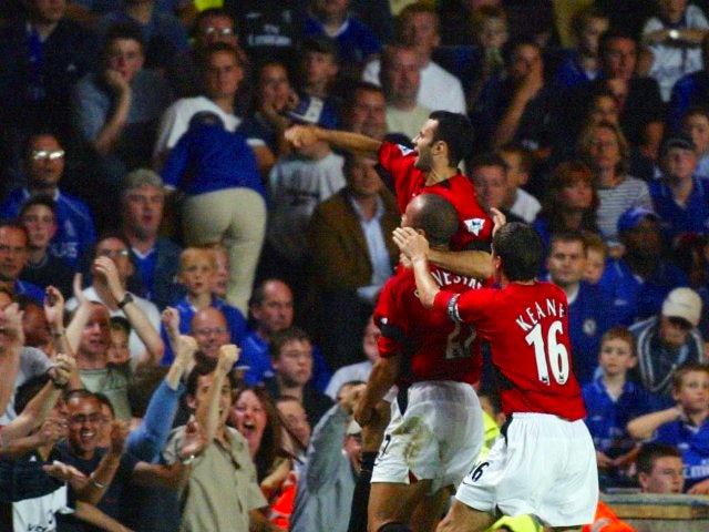 Ryan Giggs celebrates scoring for Manchester United against Chelsea on August 23, 2002.
