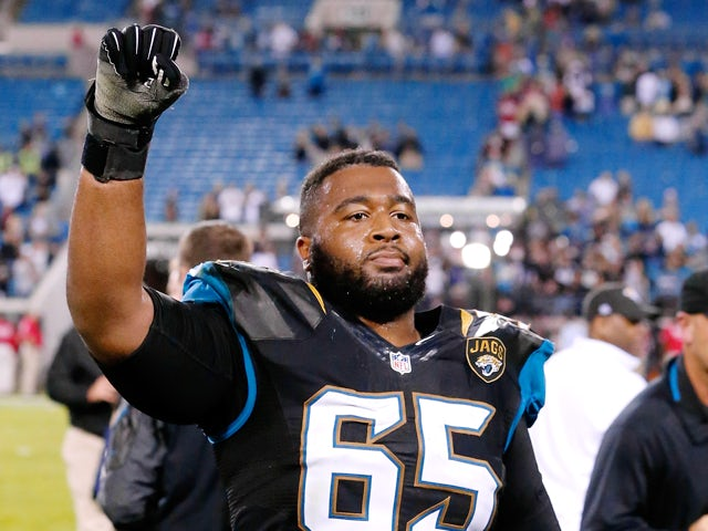 Will Rackley #65 of the Jacksonville Jaguars celebrates following a victory over the Houston Texans at EverBank Field on December 5, 2013