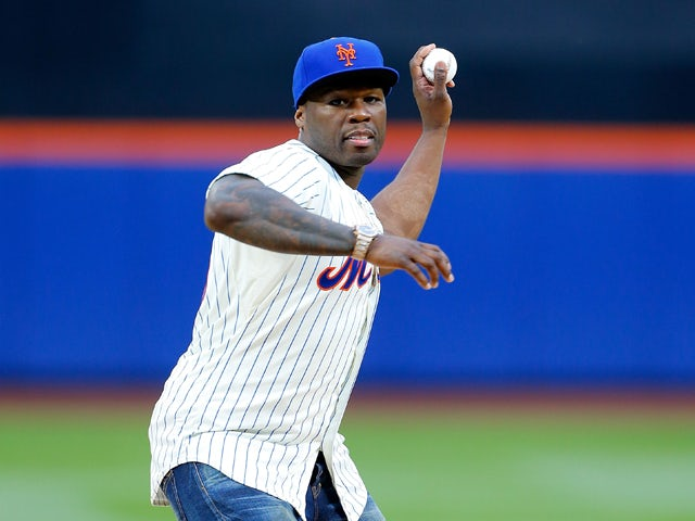 Rap artist 50 Cent throws the ceremonial first pitch of a game between the New York Mets and the Pittsburgh Pirates at Citi Field on May 27, 2014