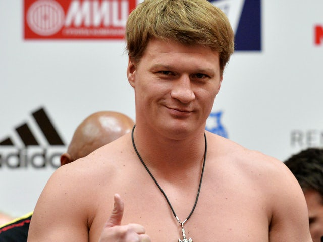 Alexander Povetkin poses during the official weigh in at the Atrium shopping centre on October 4, 2013