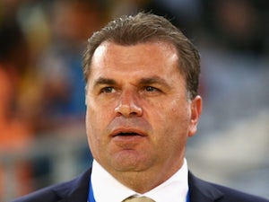 Australia coach Ange Postecoglou stands on the touchline during his side's match against South Africa on May 26, 2014.