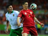 Bolivia's defender Ronald Eguino vies with Spain's forward Fernando Torres during the international friendly football match Spain vs Bolivia at the Ramon Sanchez Pizjuan stadium in Sevilla on May 30, 2014