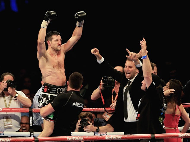 Carl Froch celebrates his win over George Groves during the IBF & WBA World Super Middleweight Title Fight at Wembley Stadium on May 31, 2014