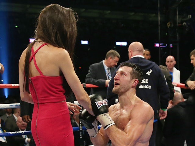 Carl Froch of England proposes following his victory against George Groves of England during their IBF and WBA World Super Middleweight title fight at Wembley Stadium on May 31, 2014