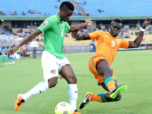 Newcastle United midfielder Cheick Tiote performs a slide tackle while on international duty with Ivory Coast on January 22, 2013.