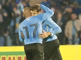 Uruguay's Cristhian Stuani and Arevalo Rios celebrate after scoring against Northern Ireland during their friendly football match at Centenario Stadium in Montevideo on May 30, 2014