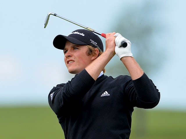 Eddie Pepperell of England watches his ball after playing an approach shot from the 9th fairway during the Nordea Masters at the PGA Sweden National on May 29, 2014