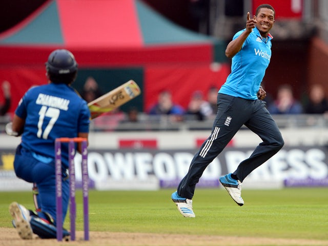 England's Chris Jordan celebrates after taking the wicket of Sri Lanka's Dinesh Chandimal during the third One Day International (ODI) cricket match between England and Sri Lanka at Old Trafford, northwest England, on May 28, 2014