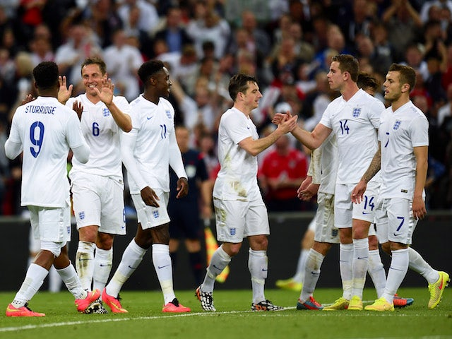 England players celebrate during the international friendly against Peru at Wembley on May 30, 2014
