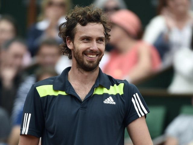 Latvia's Ernests Gulbis grins during the French Open fourth round match against Roger Federer in Paris on June 1, 2014
