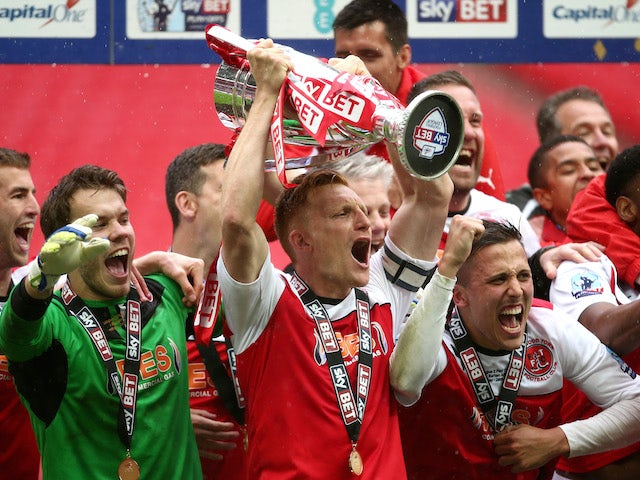 Fleetwood players celebrate promotion from Division 2 after the Sky Bet League Two Playoff Final between Burton Albion and Fleetwood Town at Wembley Stadium on May 26, 2014