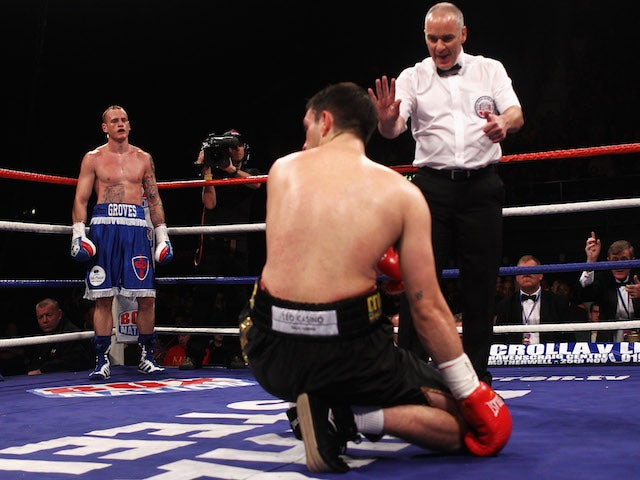 George Groves of England stands in the corner as the referee counts to Paul Smith of Engalnd in their British and Commonwealth Super-middleweight championship fight on November 5, 2011