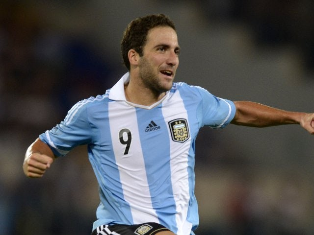 Argentina striker Gonzalo Higuain celebrates scoring for Argentina on August 14, 2013.