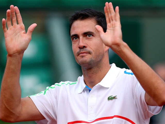 Guillermo Garcia-Lopez of Spain celebrates victory in his men's singles match against Stanislas Wawrinka of Switzerland on day two of the French Open on May 26, 2014
