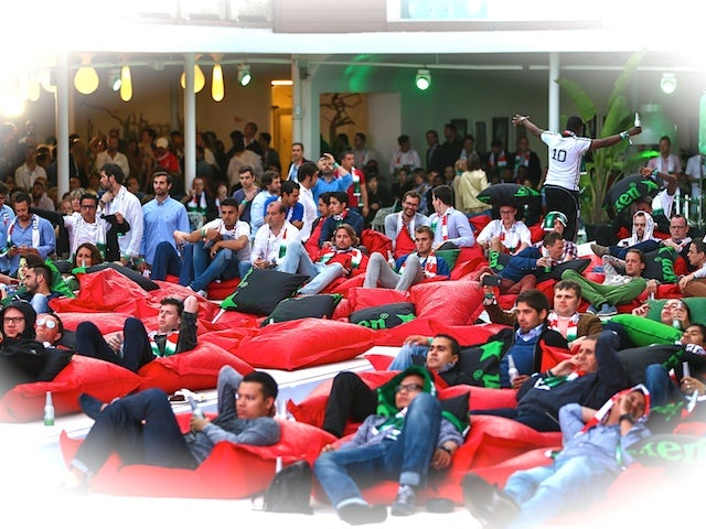 Guests watch on at the Ushuaia Beach Hotel during the Heineken Ibiza Final on May 24, 2014