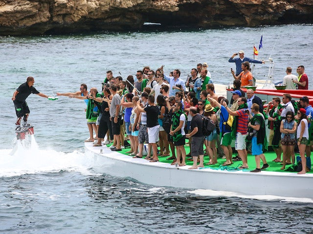 Flyboard waiters serve guests on the floating bar at the Heineken Ibiza Final on May 24, 2014