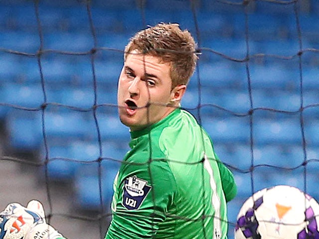 Ian lawlor, Goalkeeper of Manchester City for the opening goal during the Barclays U21 Premier League match on May 1, 2014