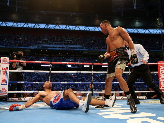 James Degale in action with Brandon Gonzalez during their IBF World Super Middleweight Final Eliminator bout at Wembley Stadium on May 31, 2014