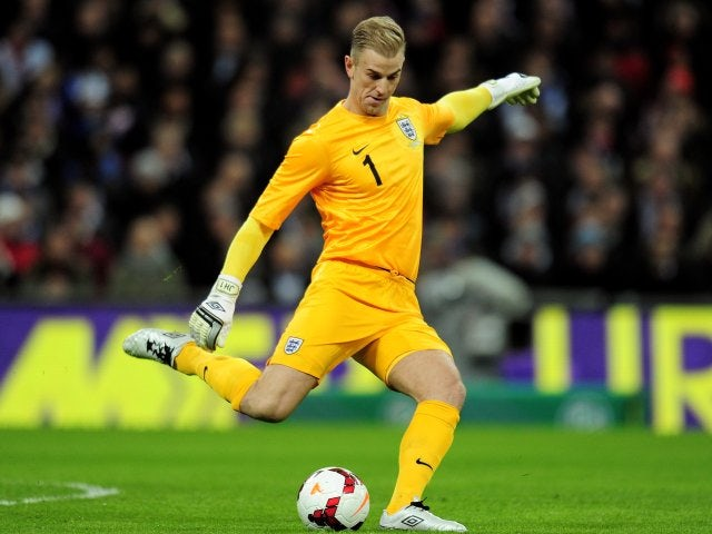 Joe Hart makes a clearance while on international duty with England on November 19, 2013.