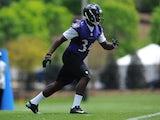 Running back Lorenzo Taliaferro #34 of the Baltimore Ravens participates in the Baltimore Ravens Rookie Minicamp on May 17, 2014