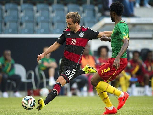 Germany's midfielder Mario Gotze (L) and Cameroon's defender Nicolas Nkoulou vie for the ball during the friendly football match on June 1, 2014